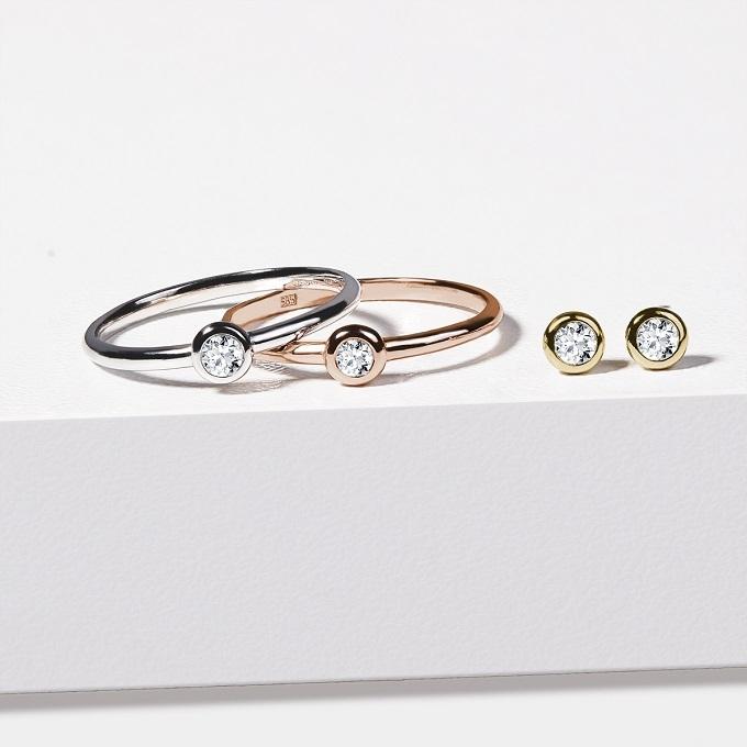 Ohrringe und Ringe aus Gold mit Diamanten in Lünette - KLENOTA
