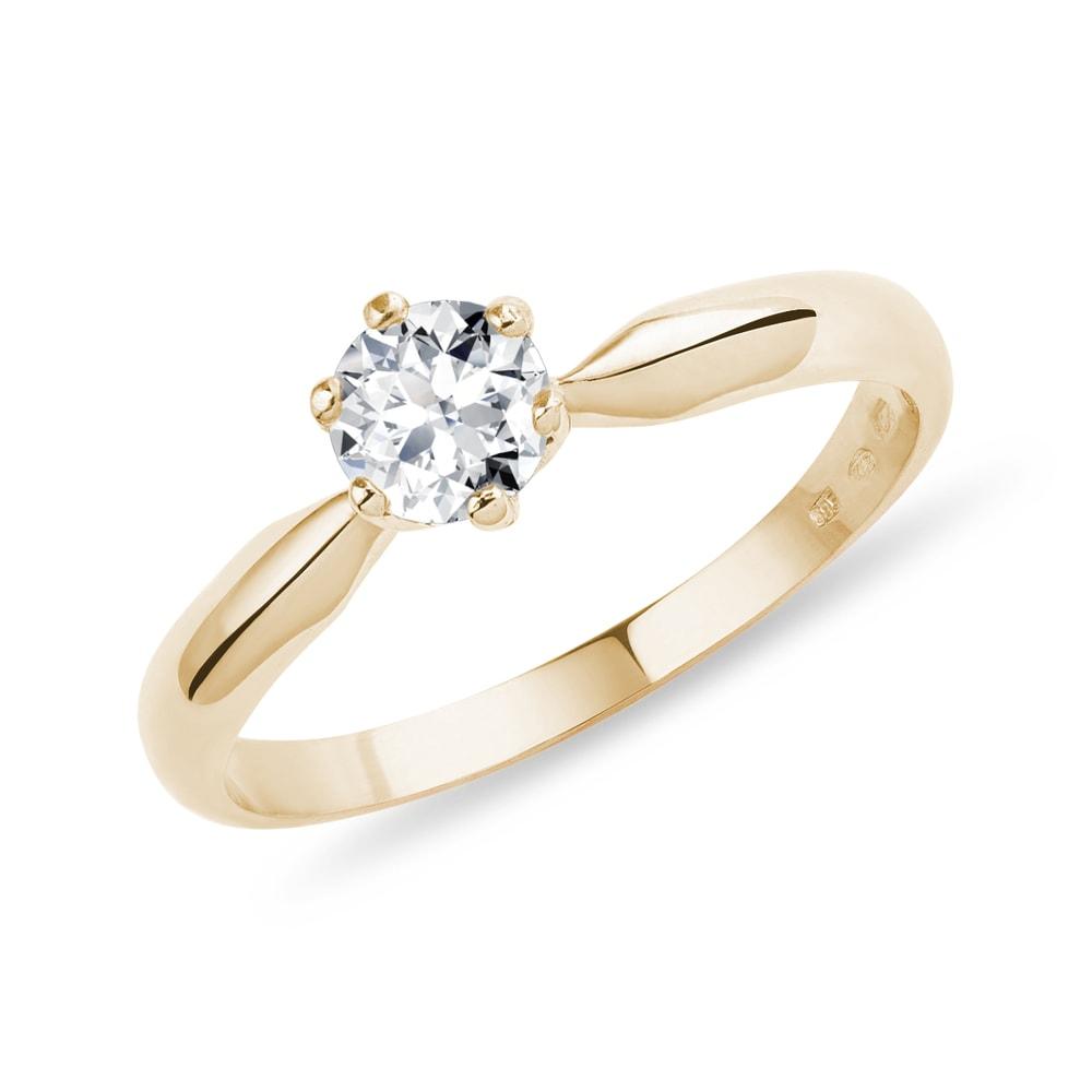 Zlatý zásnubní prsten s briliantem KLENOTA