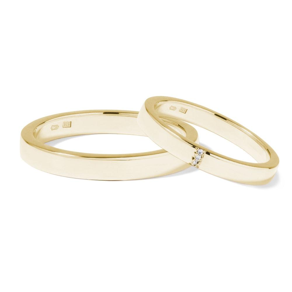 Snubní prsteny ze žlutého zlata se třemi diamanty KLENOTA