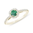 Emerald engagement ring in yellow gold