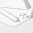 Three stone diamond necklace and earring set in yellow gold