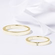 Wedding rings in yellow gold with three diamonds