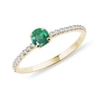 Gold ring with diamonds and an emerald
