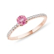 Pink sapphire ring with a diamond band in rose gold