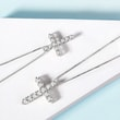 Diamond cross pendant necklace in white gold