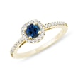 Sapphire and diamond halo ring in yellow gold