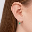 Gold earrings with emeralds
