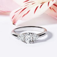 White gold engagement ring with oval and heart shaped diamonds