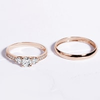 Engagement and wedding ring combination is rose gold