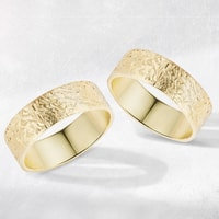 Yellow gold wedding rings with special surface