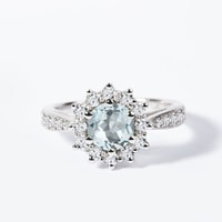 Halo engagement ring with an aquamarine and diamonds in white gold