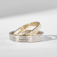 White and yellow gold wedding rings with special surface