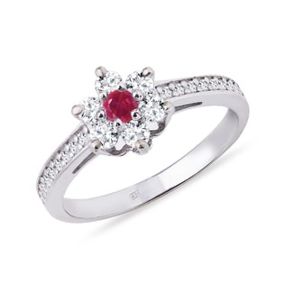 Gold diamond ring shaped flowers with ruby