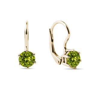 Round peridot earrings in yellow gold
