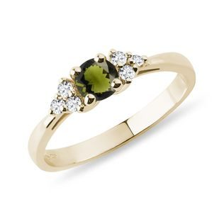 Diamonds and moldavite ring in yellow gold