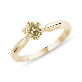 Gold engagement ring with yellow diamond