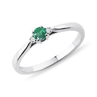 Emerald and diamond engagement ring in white gold