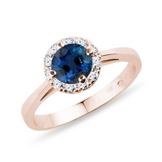Rose gold ring with sapphire and diamonds