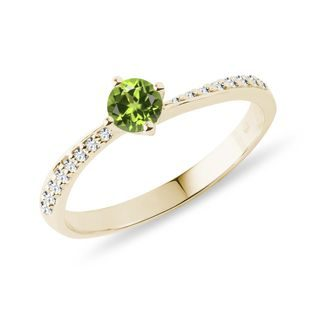Tsavorite and diamond engagement ring in gold