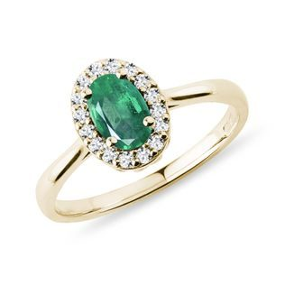 Emerald and diamond halo ring in yellow gold