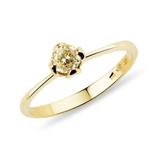 A gold ring with yellow diamond