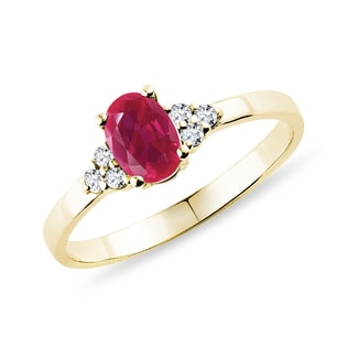 Gold diamond ring with a ruby
