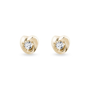 Heart-shaped earrings with diamonds