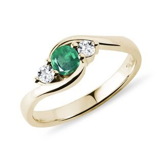 Round emerald and diamond ring in gold