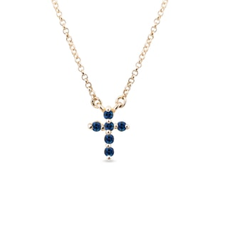 Gold cross with sapphires
