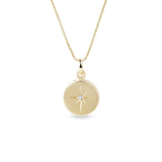Diamond star pendant in yellow gold