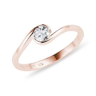 Asymmetric ring with a diamond in pink gold