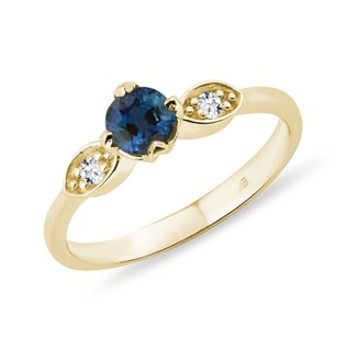 Gold sapphire ring with diamonds