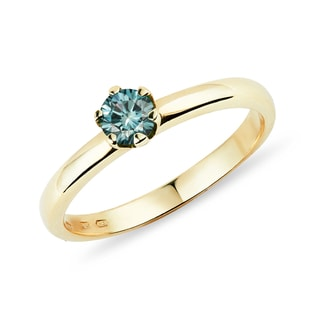 Yellow gold ring with blue diamond