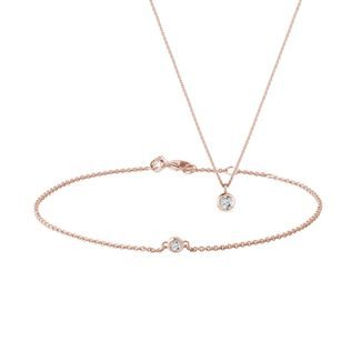Bezel-set diamond jewelry set in rose gold