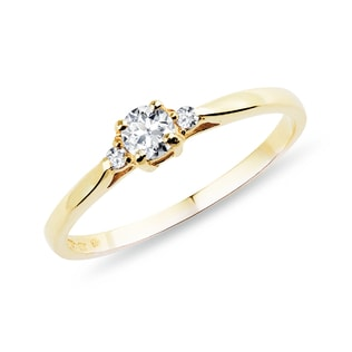 Gold engagement ring with diamonds