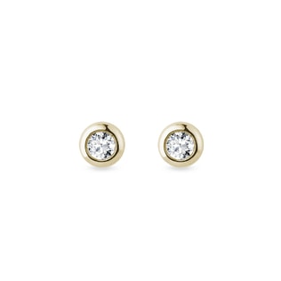 Diamond bezel earrings in yellow gold