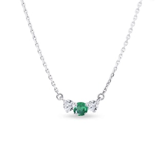 Gold diamond necklace with emerald