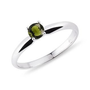 A gold ring with a moldavite