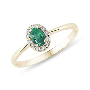 Emerald and diamond halo ring yellow gold