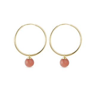 Gold hoop earrings with round sunstone pendants