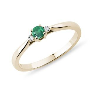 Emerald and diamond engagement ring in yellow gold