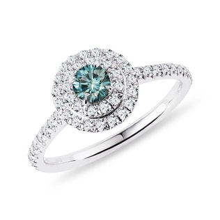 Blue diamond and diamond halo ring in white gold