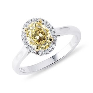 Yellow and white diamond halo ring in gold
