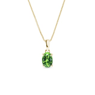 Green tsavorite pendant in yellow gold