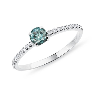 Blue diamond ring with a diamond band in white gold
