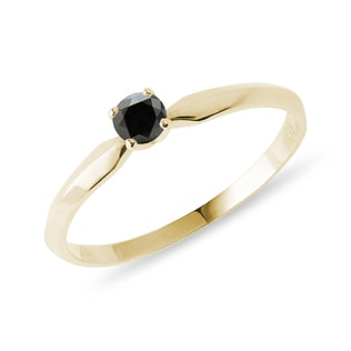 Black diamond engagement ring in yellow gold