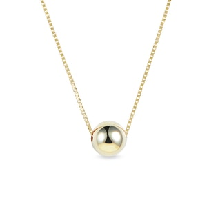 Minimalist orb pendant in yellow gold