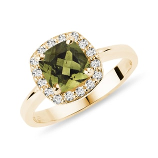 Moldavite and diamond halo ring in yellow gold