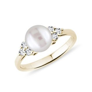 Freshwater pearl ring with diamonds in gold