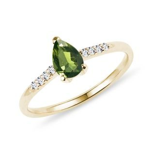 Teardrop cut moldavite and diamond ring in gold
